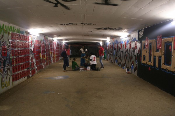 Students cover a tunnel that links East Campus to West
