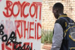 DEFACED: A student looks at the Israel Apartheid Week wall that was defaced. The words Propaganda and Brain-washed were scrawled on the wall. Event co-ordinator Tasneem Essop said she was disappointed about the vandalism. Photo: Shandukani Mulaudzi