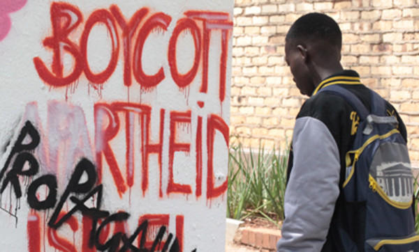 "DEFACED: A student looks at the Israel Apartheid Week wall that was defaced. The words ""Propaganda"" and Brain-washed"" were scrawled on the wall. Event co-ordinator Tasneem Essop said she was disappointed about the vandalism. Photo: Shandukani Mulaudzi"
