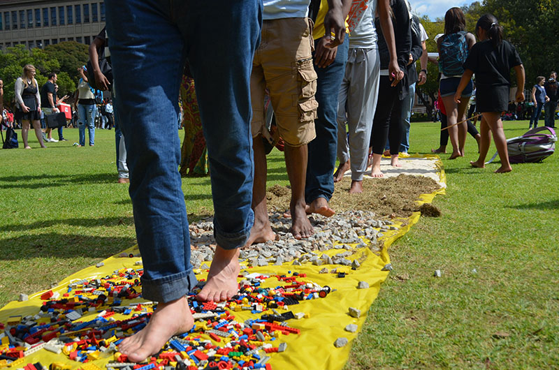 """SHOES FOR WHO?: Students take on the """"Path Without Shoes"""" to understand what it is like to live without shoes. Photo: Pheladi Sethusa"""