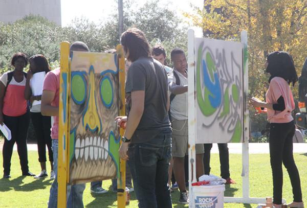 Witsies showcasing their graffiti skills on the Library Lawns. Photo: Caro Malherbe
