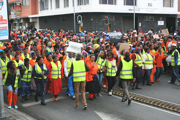 Striking Community Workers Project (CWP) members marching to the Deparment of Infrastructure and Development offices in the Johannesburg CBD.