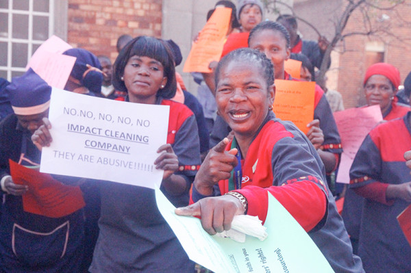 OUTWIT, OUTSMART, OUTSOURCE: Wits cleaning staff gathered outside the South West Engineering Building on Tuesday to protest against the university's sneaky outsourcing tactics.