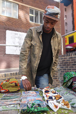 Mpumelelo Mfula organises Babatunde gear at his RHTC stall at The Grove Market in Braamfontein