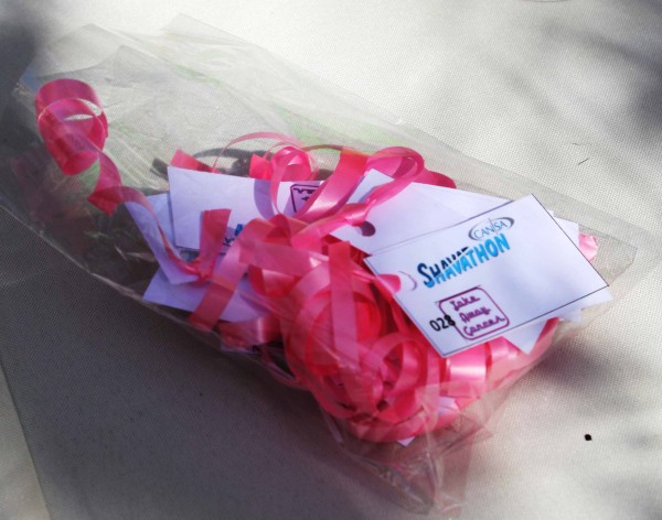 After signing up take away cancer helpers gave students a pink ribbon, symbolic of cancer and more specifically breast cancer. With the ribbon came a Shavathon card which you trade in after your shave/spray and recieve a free ice-cream. Photo: Prelene Singh