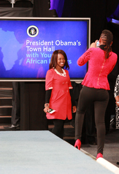 Guests enthusiastically photographing  themselves inside the auditorium where Obama spoke. Photo: Dinesh Balliah.