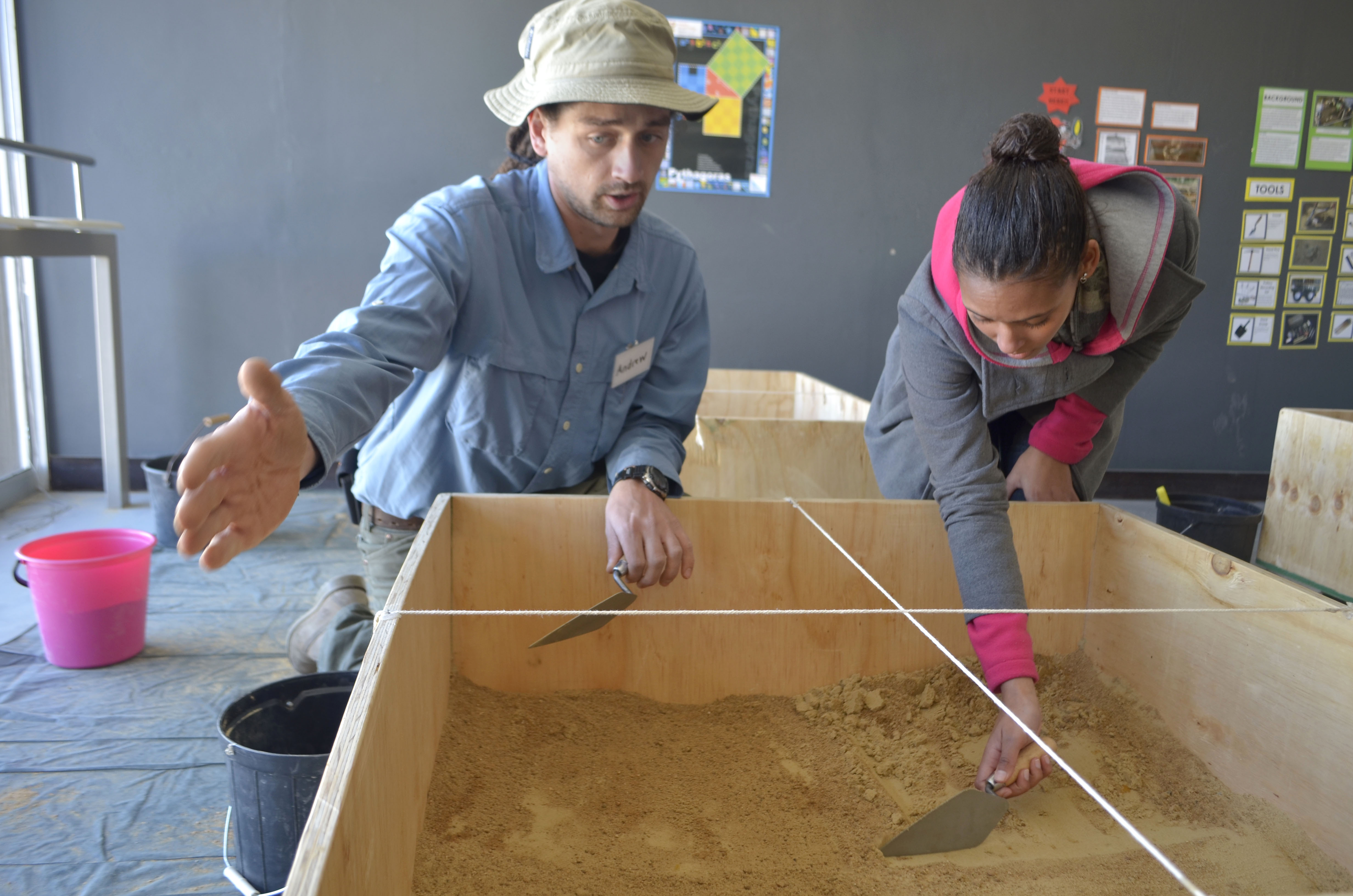 DIG IN: Andrew van der Heever shows a student how to excavate. Photo: Pheladi Sethusa