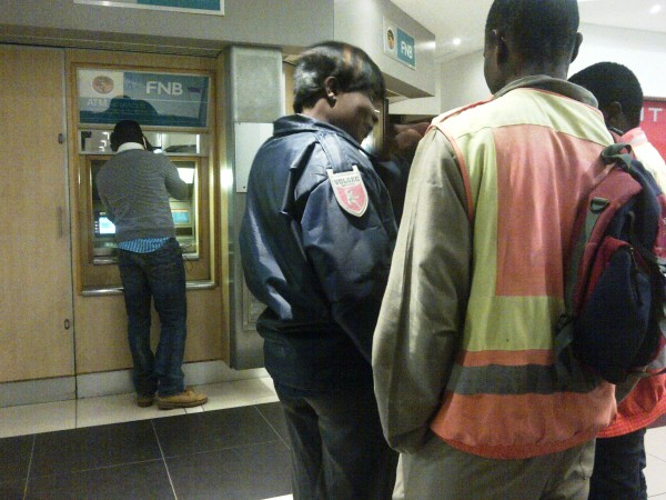 CONNED: Segun and the ATM trying to find his card Photo:Nokuthula Manyathi