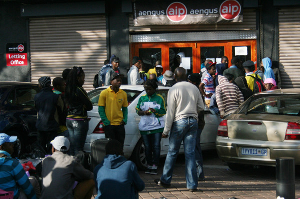 Students queue outside the Aengus offices in Braamfontein waiting for accomodation. Photo:Ray Mahlaka