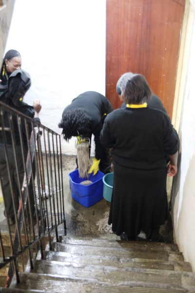 WATER WORLD: University Corner cleaners mopping the stairway after a pipe in the female toilets burst.  Photo: Nokuthula Manyathi