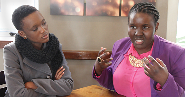Tumelo Mothotjoane listens intently as Zamantungwa Khumalo speaks balancing academics and work. Photo: Shandukani Mulaudzi