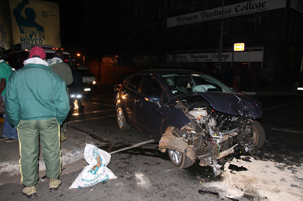 ACCIDENT ZONE: Firefighters inspect the damage to a Ford Fiesta involved in the crash.           Photo: Dineo Bendile