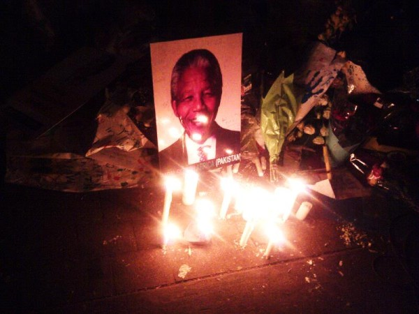 WE LOVE YOU TATA: Candles light up and image of Nelson Mandela and the world prays for his speedy recovery. Photo: Nokuthula Manyathi