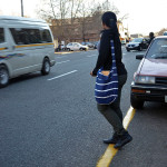 Ntombi Mbatha carefully crosses the street. Photo: Pheladi Sethusa
