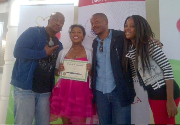 SHE'S GOT THE X FACTOR: Talent show judges with the winner of competition (From Left)DJ Fresh, Erica Da Silva Mpho Osei Tutu and Thuso Mbedu
