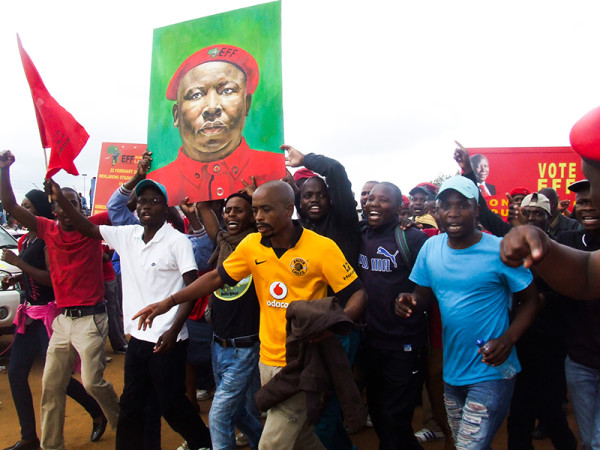 JUJU JIVE: EFF supporters, as always, were in high spirits when they marched into Mehlareng Stadium on Saturday.  Buoyed by the manifesto launch and the party's release of a music CD, they danced and danced.           Photo: Luke Matthews