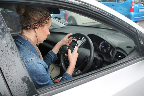 TEXTING: Wits Vuvuzela's Tracey Ruff illustrates the dangers of texting and driving.
