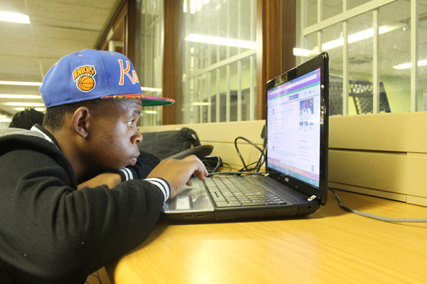 Against all odds: Jeffrey Choma pictured outside CNS, is one of the few students successfully registered for Wits  WiFi services.              Photo: Luke Matthews