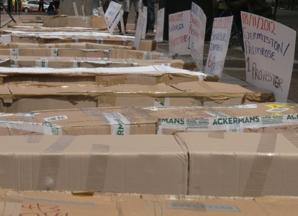 Cardboard coffins lined the entrance to the Joburg Central Police Station. Photo: Roxanne Joseph