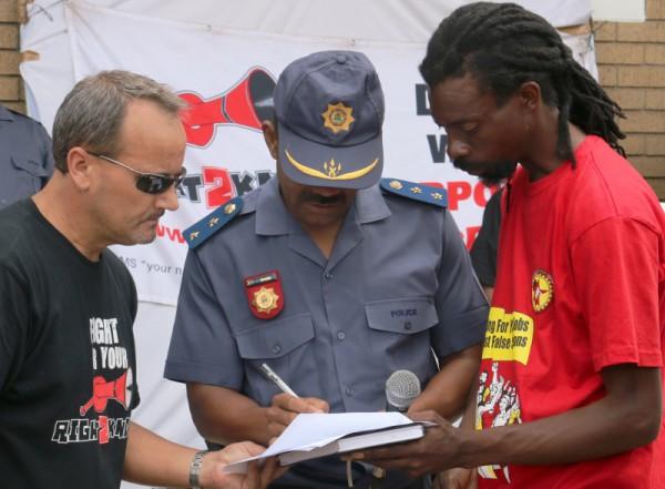 Station Commander, Chester Spies signs the R2K memorandum. Photo: Roxanne Joseph
