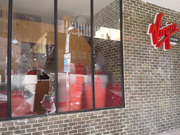 BROKEN GLASS: The window of Braamfontein's Virgin Mobile was the only sign that the shop had been broken into to early this morning. Photo: Roxanne Joseph