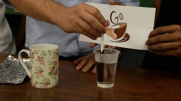 """STICKY"" CAFFEINE:  Industrial engineers demonstrate how the coffee sticks dissolve when stirred in hot water. Photo: Luke Matthews"