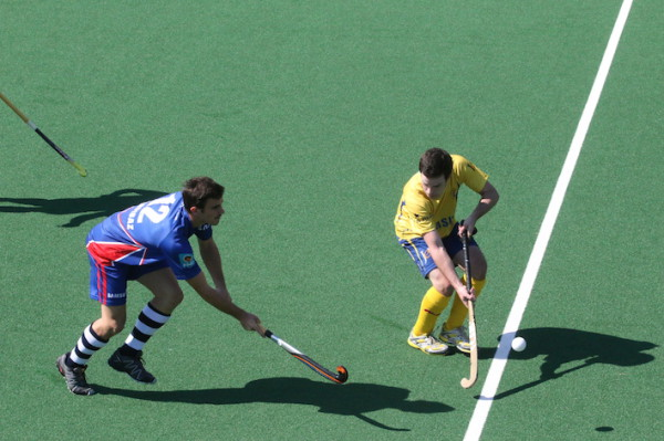 Madibaz (NMMU) in blue and Wits in yellow in focus during their Varsity Hockey tournament match on Wits turf yesterday afternoon. Photo: Tendai Dube