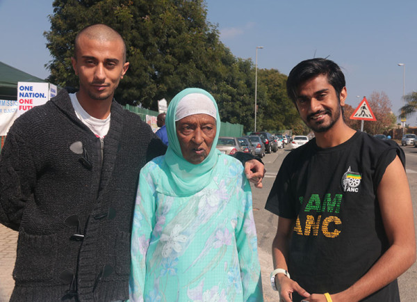 POLITICAL LINES: Fatima Verachia, 86, accompanied by her grandchildren Zubair Verachia, 23 (left) and Shafee Verachia, 22 (right) to the Malboro Gardens voting station