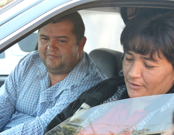 BANNED DRIVER: Nymhardt Black (48) sits in the car with his wife Debbie Black (40) after voting and wait to speak to an IEC member to lodge their complaint. Photo: Luke Matthews