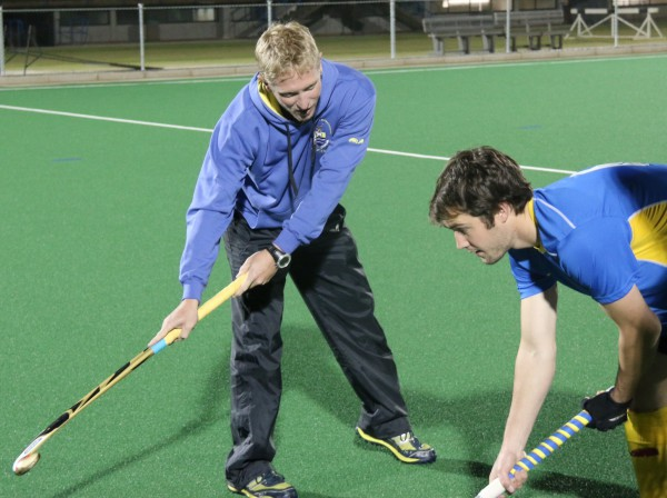 PASSIONATE COACH: Mark Sanders,Wits men's hockey coach, shows his player, Matthew Povall a trick or two. Photo: Luca Kotton