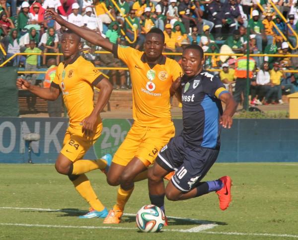TIGHt BATTLE: The Clever Boys captain, Sibusiso Vilakazi, gets chased by Kaizer Cheifs Defender Erik Mathoho. Photo: Luca Kotton