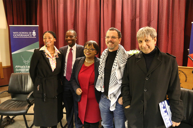 PLAN PANEL: (left to right) Nonkululeko Nyembezi-Heita (CEO of Ichor Coal NV), Khulekani Mathe (Head of NPC Secretariat), Siki Mgabadeli (Moderator), Neil Coleman (COSATU strategist), Adam Habib (Wits Vice-Chancellor), standing together at the Wits School of Governance, after the first debate on Implementing the NDP,  Thursday 24 July.                       Photo: Zelmarie Goosen.