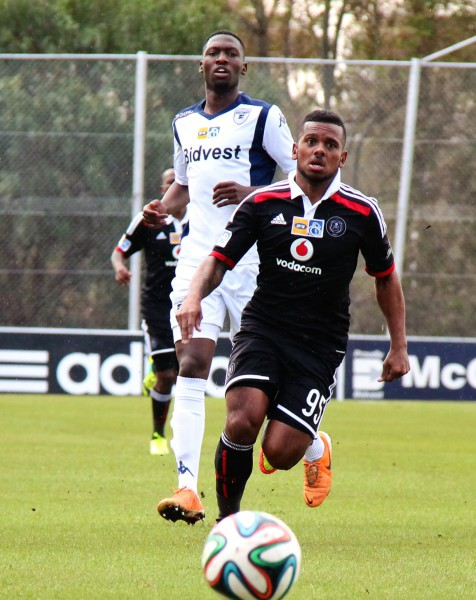 CHASING DOWN: Buhle Mkhwanazi of Bidvest Wits watches Kermit Erasmus run past him during their MTN8 semi-final clash. As the picture suggests, the Clever boys are chasing Pirates after the Buccaneers took a two goal lead in the two match tie. Photo: Luca Kotton