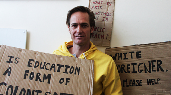 READ THE SIGNS: Anthony Schrag often uses pieces of cardboard with phrases or questions written on them to engage people in his work.                     Photo: Robyn  Kirk