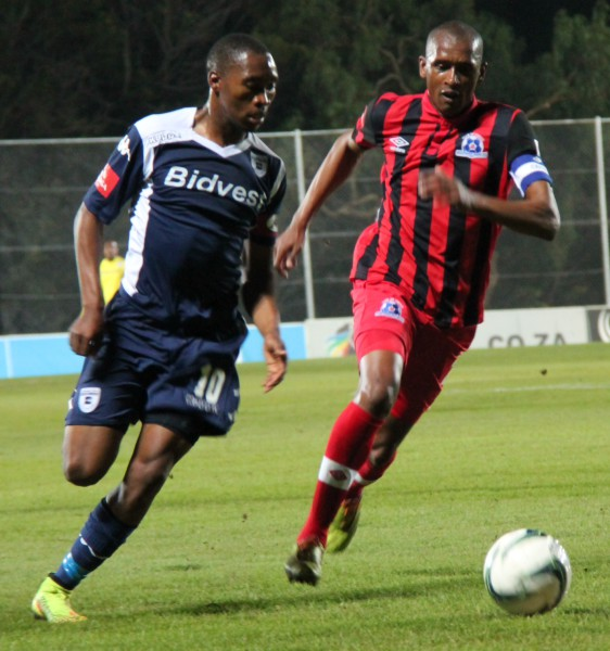 CAPTAINS DUEL: Sibusiso Vilakazi battles for the ball with Maritzburg United captain Ashley Hartog in a match which saw the Clever Boys create multiple chances but manage to only score a solitary goal. Photo: Luca Kotton