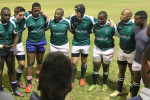 Engineers in a huddle at the Wednesday night game where they beat Men's Residence, 10 - 5.    Photo: Tendai Dube