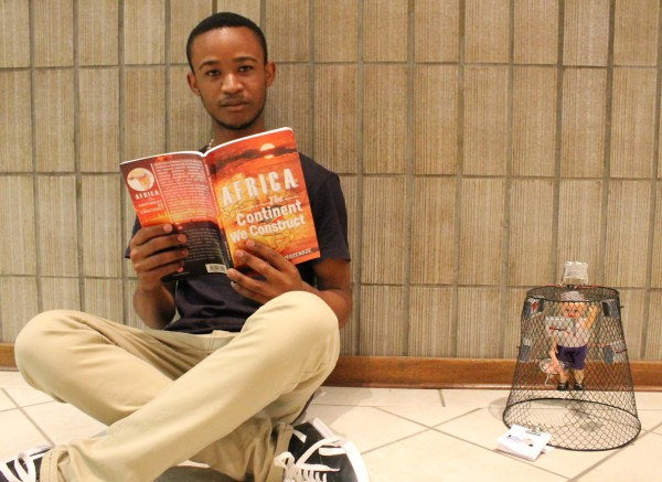 BOOK SMART: Second-year student Bhaso Ndzendze reads a verse of his newly published book Africa: The Continent We Construct. Photo: Ilanit Chernick