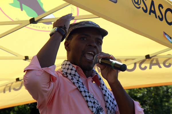 Former Wits SRC president, Mcebo Dlamini during his speech at the IAW rally.