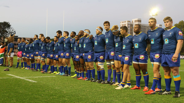 SHOULDER-TO-SHOULDER: FNB Wits standing side-by-side singing the national anthem before kick-off.   Photo: Anlerie de Wet