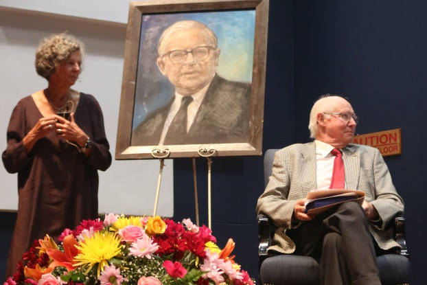 Ruth Rice and Dr Sholto Cross alongside a portrait of Bram Fischer that was commissioned from a photograph and donated. Photo: Tanisha Heiberg