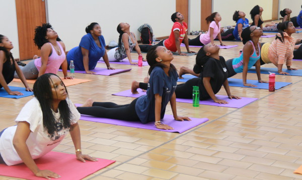 Exhale: Students in position during a Bhakti Yoga session on Wednesday afternoon.                                                                                                 Photo: Tendai Dube