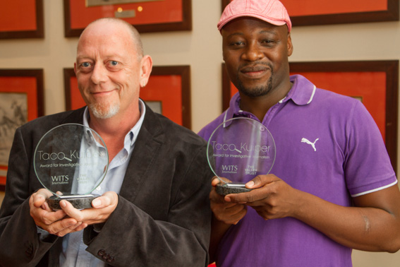 WINNERS: Paddy Harper, left, and Sipho Masondo, right, of the City Press won the 2014 Taco Kuiper award for investigative journalism last Friday at the Rand Club in Johannesburg. Photo: TJ Lemon.