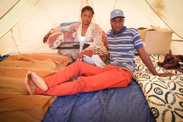 SAFE HAVEN: Living in a tent, Mozambican national Sam Philane and his partner Angelina Chiabo have fled their home in Primrose, fearing xenophobic violence. They have taken shelter at a camp established by charity Gift of the givers in Mayfair.            Photo: Sibongile Machika