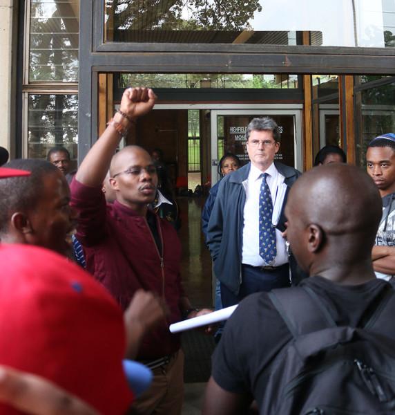 ARC President Mxolisi Sopiseka handing over the Memorandum to the head of Residence Life Rob Sharman.