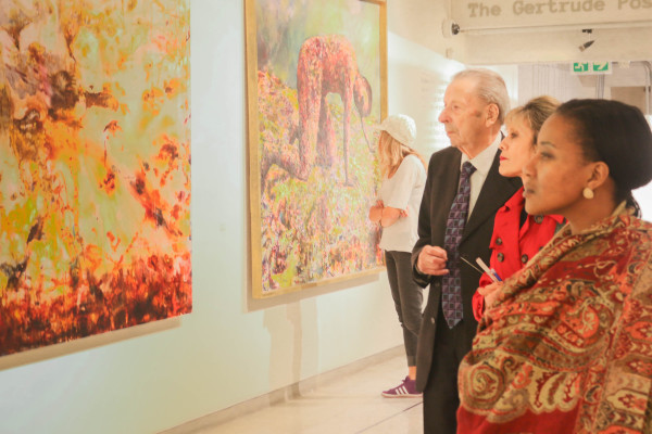 RETROSPECTIVE VIEW: Exhibition goers take a look at one of Siopis' works. Photo: Katleho Sekhotho