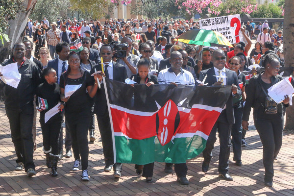 NATIONAL PRIDE: Kenyans and supporters of the Kenyan Solidarity March today walk proudly with the Kenya flag  Photo by: Reuven Blignault