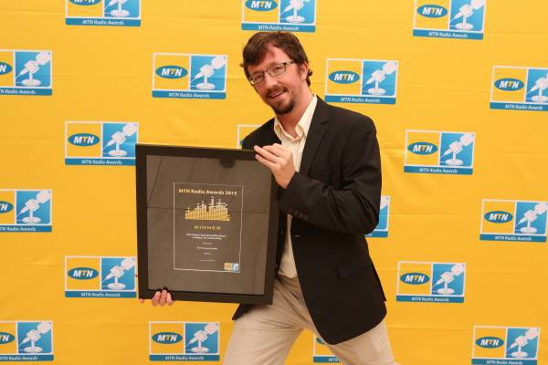 HEAR IT, FEEL IT, LIVE IT: Paul McNally holding one of his awards. Photo: provided