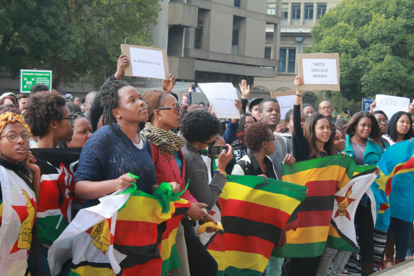 "WE ARE ALL AFRICANS: Wits students, united outside the Wits Great Hall steps against xenophobia. The message was very clear, according to Vice Chancellor Adam Habib ""everyone at Wits on Wednesday was an Africa.""     Photo: Anelisa Tuswa"