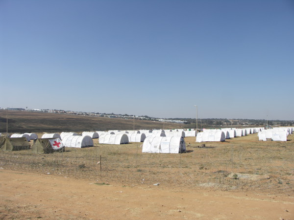 United Nations High Commissioner for Refugees (UNHCR) tents at a refugee camp in Midrand, Johannesburg, during the 2008 xenophobic violence and rioting. Source: Wikimedia Commons