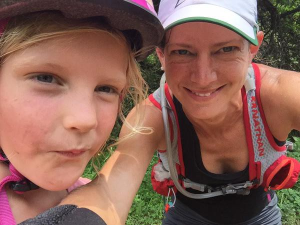 Wostmann and her daughter Gabriella, 7, on a run through on the muddy Sabie trail. Photo: Twiiter @11Caz11